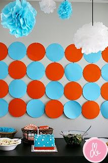 orange and turquoise baby shower... Not crazy about orange.. but I guess it's kind of Thunder colors too?? lol