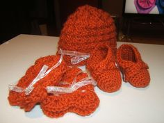Baby hat, mittens, and booties I made for a friend.  Fall Leaf Orange