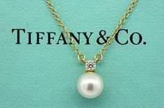 TIFFANY & CO.18K YELLOW GOLD .05CT DIAMOND PEARL PENDANT NECKLACE. Get the lowest price on TIFFANY & CO.18K YELLOW GOLD .05CT DIAMOND PEARL PENDANT NECKLACE and other fabulous designer clothing and accessories! Shop Tradesy now