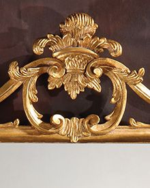 Chippendale style carved wood mirror with leaf and scroll design,finished in antiqued goldleaf; made in Italy