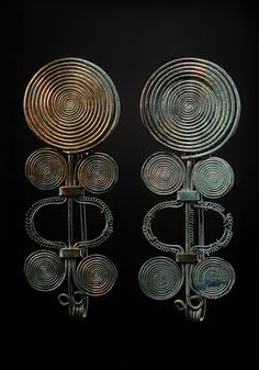 """ A Pair of Bronze Spiral Fibulas Culture : European, Bronze Age Period : late 2nd – early 1st millennium B.C. Material : Bronze """