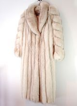 I KNOW  it isn't right to wear real furs...but you have to admit, this does look warm and wonderful~  which is likely what the fox thought too    Vintage SAGA Fox Fur Coat