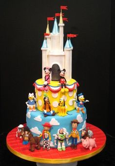 Cute #Disney World character cake---I want to have this cake done for Maddies birthday (but with pink and princesses on bottom)