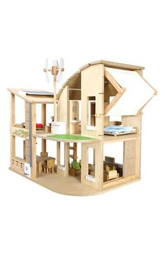 eco-conscious dollhouse.  contemporary energy-efficient features like a wind turbine, a solar-cell panel, an electric inverter for generating electricity and a rain barrel for collecting rain. A biofacade grows plants for shading, and an adjustable blind allows custom responses to sunlight and air ...