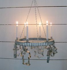 Clever christmas candle holder - who knew a tart pan rim and cookie cutters could make a candle chandelier. Scandinavian Christmas, Modern Christmas, Christmas Love, Christmas And New Year, Vintage Christmas, Christmas Wreaths, Christmas Crafts, Christmas Decorations, Christmas Ornaments