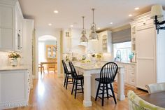 Light and airy white kitchen with contrasting black accents