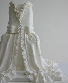 Awesome...Lace and Ruffles Wedding cake:A classic white elegant cake with decorative lace, pearls and ruffles