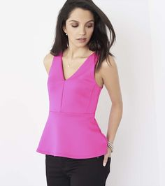 Dress to frill. Ensure all eyes are on you with this gorgeous scuba peplum top.