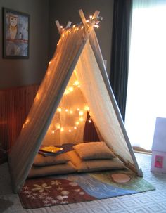 Playroom Canvas Reading Tent. The most fun thing for a child's room! Great job!! What materials needed: Canvas drop cloth (neutral  color); 5, 1x2x6 Select Pine Boards; 1, 1x3x6 Select Pine Board; 2, 8mm hex head bolts - 50mm long; 4, 8mm hex head bolts - 60mm long; 6, 8mm hex nuts; Staples (for fabric); lights (optional)