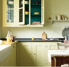 teal cabinet interior, dark grey counters, pale yellow everything else.