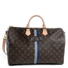 This is an authentic LOUIS VUITTON Mon Monogram Speedy Bandouliere 40 in Gris and Bleu Marine. This is the largest size of the iconic Speedy bag and is crafted of classic Louis Vuitton monogram toile canvas complimented with Louis Vuitton signature natural vachetta cowhide leather including a shoulder strap.