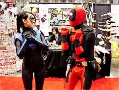 Oh! I love you Deadpool!!! Don't you just love it when Cosplayers actually get into characters?!?