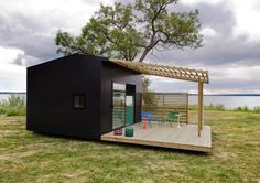 Black cabin on the water