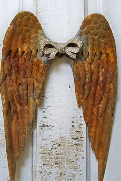Rusted metal angel wings wall sculpture with by AnitaSperoDesign
