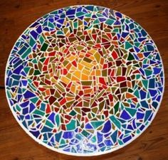 8 Steps to Making a Mosaic Tabletop It isn't too often that you can make something more beautiful than the original out of recycled materials. Using an old jar as a glass? Not so beautiful. Reusing a plastic margarine tub as Tupperware? Not so glamorous. But this—a mosaic tabletop fashioned from leftover tile scraps—this is beauty! Here's how you get started: