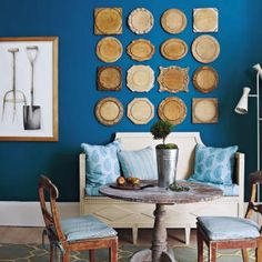 The plates are such an awesome idea and would be pretty cheap to find at yard sales.  Also, really like the rich wall color.