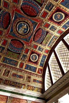 ancient roman decorative art used on the ceiling as seen in many ancient rome designs with bright rich red blue and yellow colours which were predominant - Ancient Rome Designs
