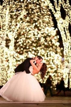 Twinkling lights make this wedding photo extra magical.