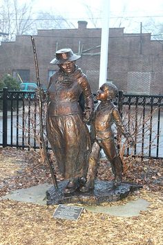 Statue of Harriet Tubman with a young boy by sculptor Jane DeDecker at the Ypsilanti District Library at 229 W. in Ypsilanti, Michigan. The statue was installed in Native American History, African History, African American History, American Women, Statues, Black History Facts, Black History Month, Harriet Tubman, African Diaspora
