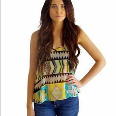 Aztec Print Sheer Top Really cute print on this sheer top. Has v neck front and also a low back v in back with a strap between shoulder blades. New with tags. 100% polyester Tops Blouses