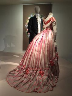 "Later 1860s striped rose silk evening dress. ""Fashion Forward"" exhibit, Musee de Arts Decoratifs. Photo by Charity Calvin Armstead via Facebook."