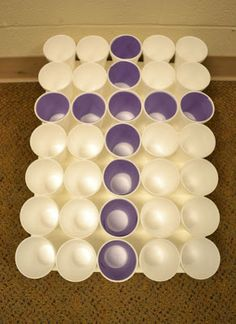 Cross Toss - Purple paper is rolled and inserted in some cups to make a cross.  The kids try to get plastic eggs in the purple cups.