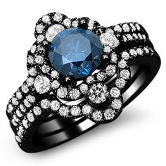 2.0ct Fancy Blue Round Diamond Engagement Ring. 18k Black Gold with a .75ct Center Diamond and 1.25ct of Surrounding Diamonds.