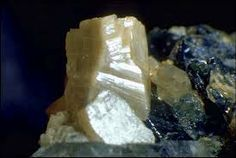 Whiteite-(MnFeMg), {(Mn2+,Ca)}{(Fe2+,Mn2+)}{Mg2}{Al2}(PO4)4(OH)2 · 8H2O. Named after John Sampson White, Jr., associate curator of minerals, Smithsonian institution; founder, editor and publisher (1970-1982) of the Mineralogical Record. Colour:Brown.Type Locality:Ilha claim, Taquaral, Itinga, Jequitinhonha valley, Minas Gerais, Brazil.