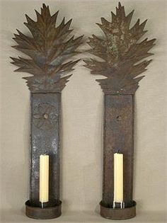 an exceptional Pair of Tinned Sheet Iron Sconces with Oak Leaf Crests…originally from a Church in Bedford County, Western Pennsylvania…Dating from the mid 1800s'…these sconces are one pair of probably ten pair known…several pa both Sconces are structurally reinforced on the back and one Sconce is slightly more worn…These tin sconces are attributed to Nelson Garey ( 1820-1910 ), a Tinsmith from Berlin, Pennsylvania who crafted from 1850 to 1875. ex Machmer Collection