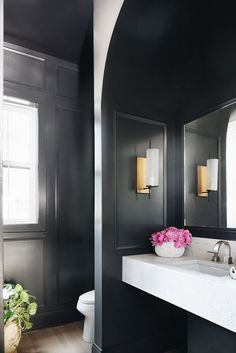 sink in guest bathroom. This powder room features black paneled walls, painted in Benjamin Moore Wrought Iron and a marble-looking floating vanity Luxury Interior Design, Home Interior, Interior Plants, Modern Rustic, Modern Farmhouse, Farmhouse Style, Farmhouse Interior, Farmhouse Design, Farmhouse Bathrooms