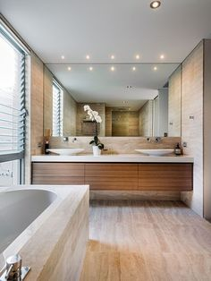 Contemporary Bathroom with warm tones from wood cabinetry  If mix wood vanity with travertine tile...?