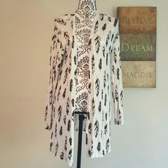 So soft, Beautiful Feather Cardigan This lightweight beautiful cardigan is perfect for spring/ summer nights! Size medium but can fit a small to large.  97% Viscose 3% Elastane Philosophy Sweaters Cardigans