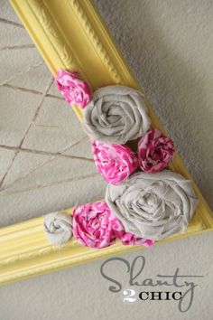 Homemade flowers on picture frame... I love this!
