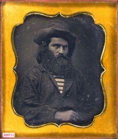 ca. 1850's, [daguerreotype portrait of a gentleman with large beard, wearing hat, work shirt, horizontal striped miner shirt] via the Daguerreian Society, Matthew R. Isenburg Collection