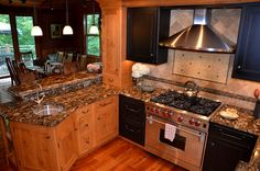 This kitchen was designed around the drama of the Black Mosaic (aka Black Marinace) granite countertops.  The tile backsplash features natural stone tile used in two sizes along with metal tile borders and inserts.  Kitchen by Stoneshop from Cherry Hill, NJ.