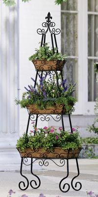 to Container Gardening Vertical garden- would be great for annual herbs right outside the kitchen.Vertical garden- would be great for annual herbs right outside the kitchen. Patio Planters, Planter Pots, Tiered Planter, Backyard Patio, Vertical Planter, Porch Planter, Concrete Backyard, Tiered Garden, Pergola Patio