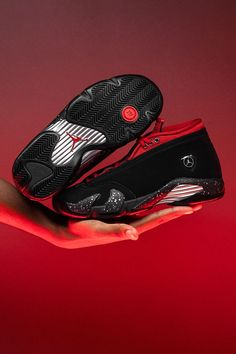 """The Air Jordan 14, which is inspired by Michael Jordan's Ferrari 550 Maranello, finds a new source of inspiration for this Fall 2021 release. Dubbed """"Red Lipstick,"""" the black-and-red colorway nods to the forever popular cosmetic product. Jordan 14, Michael Jordan, Red Lipsticks, Air Jordans, Street Wear, Sneakers, Shopping, Shoes, Black"""