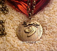 Rhodesian RIDGEBACK LOCKET NECKLACE with Lion. Vintage Style Jewelry for Dog Lovers by Cloud K9 / Holds 2 Photos on Etsy, $39.95