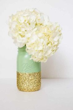 This is very similar to My centerpieces! Except the gold won't be a glittery gold. And the flowers will be hydrangeas and coral roses