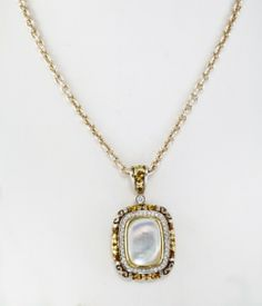Sterling Silver and 18K Yellow Gold Mother of Pearl Pendant: This sterling silver and 18k yellow gold pendant features 43 diamonds that weigh a total of 0.25 carats and one 14x10mm Mother of Pearl. $2,500.00.