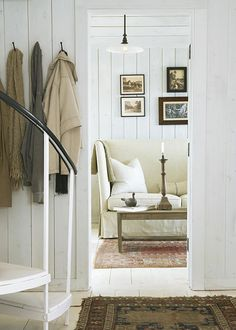 """Country Home: """"Choose a simple color scheme for a small space. Here, pickled floors and whitewashed walls and ceilings add texture and keep small rooms light and bright."""""""
