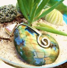 hand carved labradorite pendant set with sterling silver