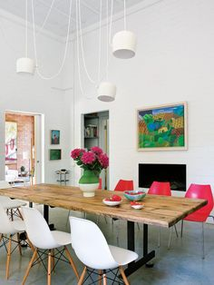 Flourishes of vivid pink, floral accents and bright seating work in harmony with white FLOS Aim pendant lights to make this dining area pop. Flos, Dining Room Furniture, Living Room White, Dining Room Contemporary, Flos Living Room, Room, Modern Dining Room, Dining, Furniture Choice