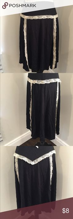 Black Cotton Skirt Cream lace Detail Sz Medium Black Cotton Skirt with Cream Lace Detail Brand is unknown Size is unknown Approximately size Medium the skirt is a very stretchy material Please feel free to ask any questions! Skirts