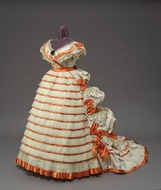 Evening dress by Mme. Roger, ca. 1865 [I think this is closer to 1870 than 1865.] In the Swan's Shadow.