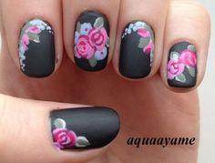 Floral Black Matte Nail Art.