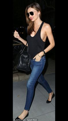 d9c99a08bba6 Miranda Kerr was lucky to avoid a wardrobe malfunction as she donned a  daring top in New York
