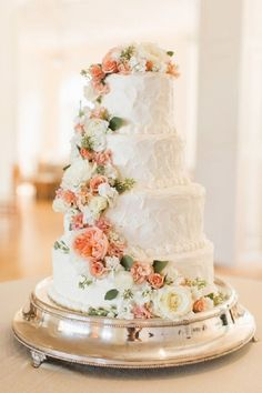 Four tier wedding cake with peach and white cascading flowers #weddingcake #cakes #rosecascading #inspiration