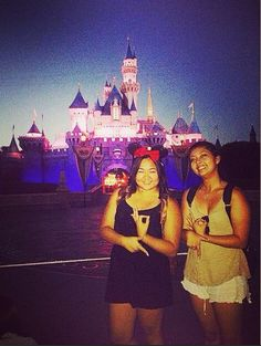 Sisters from Alpha Gamma throwing what they know in front of sleeping beauty's castle in Disneyland