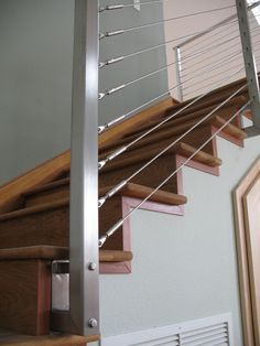 Interior metal stair railing by Ramsey  Iron. More info here:  http://santacruzconstructionguild.us/ramsey-iron